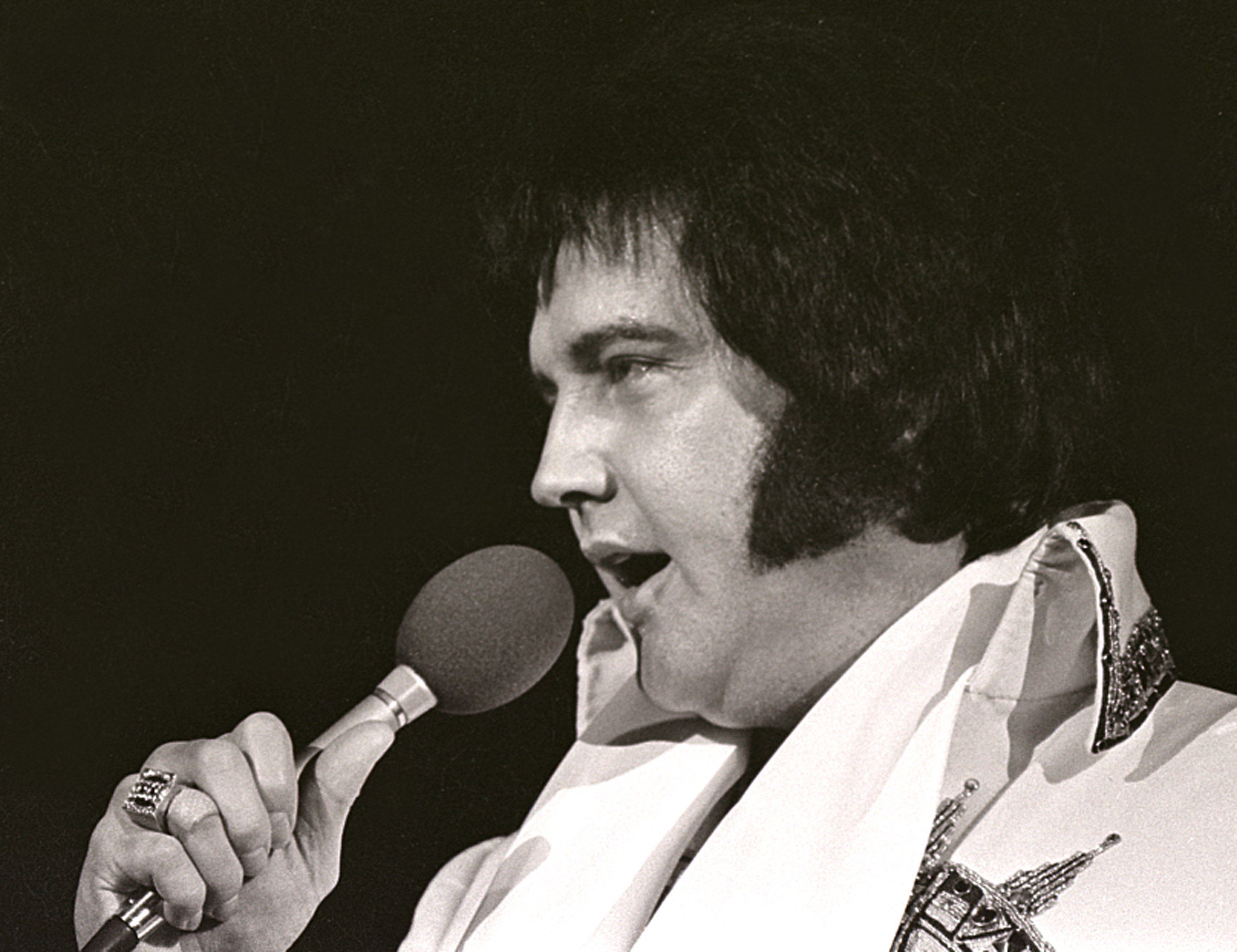 Elvis Presley performs in a concert in Milwaukee, Wisconsin in 1977   Source: Getty Images