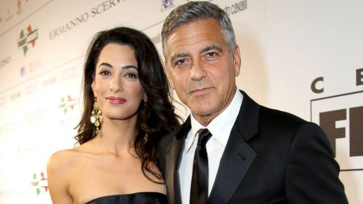 Human rights lawyer Amal Clooney with husband actor George Clooney. | Photo: Flickr
