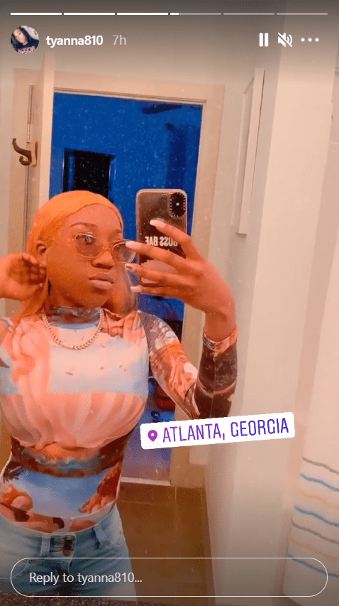 T'yanna Wallace poses in a mirror selfie sporting a renaissance-print turtleneck. | Photo: Instagram/tyanna180