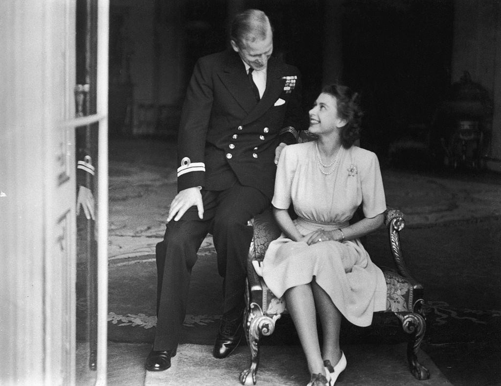 Princess Elizabeth (later Queen Elizabeth II) and Prince Philip at Buckingham Palace, 10th July 1947 | Photo: Getty Images