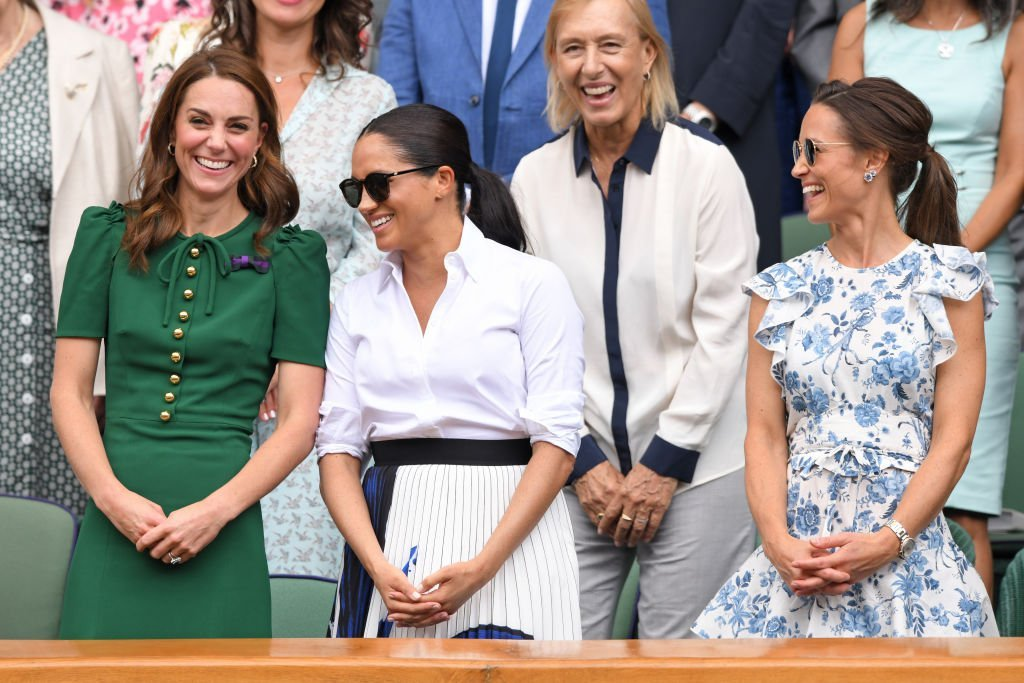 Kate Middleton, Martina Navratilova, Meghan Markle, and Pippa Middleton in the Royal Box on Centre Court during day twelve of the Wimbledon Tennis Championships at All England Lawn Tennis and Croquet Club | Photo: Getty Images