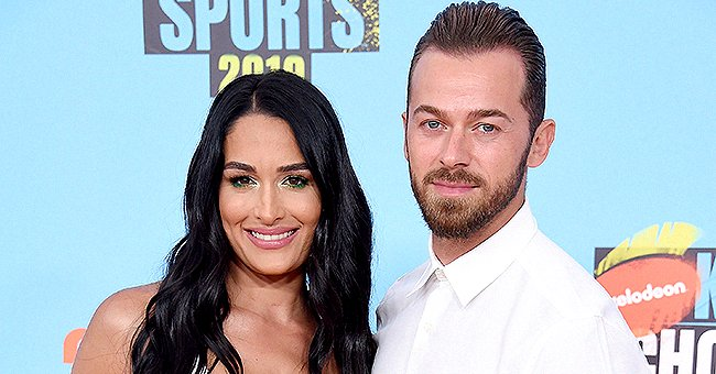 Heavily Pregnant Nikki Bella Puts Her Growing Baby Bump on Display in a Red Top