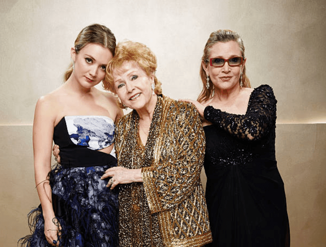 Billie Lourd, Carrie Fisher and Debbie Reynolds pose as a family on the red carpet for TNT's 21st Annual Screen Actors Guild Awards on January 25, 2015, in Los Angeles, California | Source: Getty Images (Photo by Kevin Mazur/WireImage)