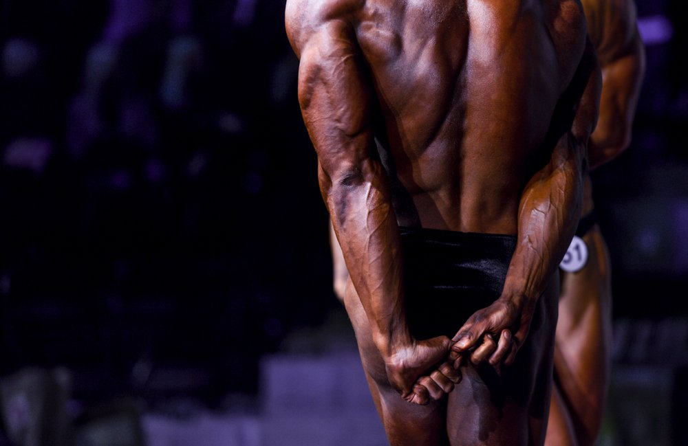 A man flexing his muscles ready to show if off.   Photo: Shutterstock