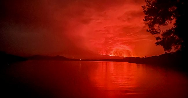 A view across Lake Kivu, that show the flames caused from the volcanic eruption of Mount Nyiragongo. 2021.   Photo: Getty Images