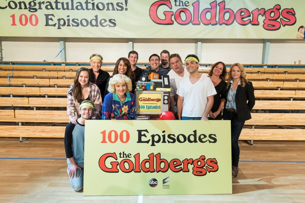 """""""The Goldbergs"""" cast pose for a photo at event celebrating the 100th episode. 
