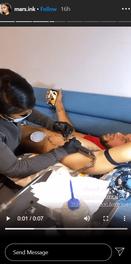 Stephen Curry lying on a couch while getting his tattoo done. | Photo: Instagram/Mars.ink