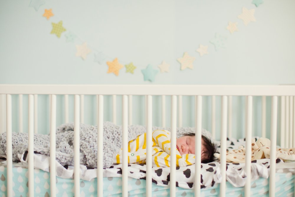 A photo of a newborn baby in the crib.   Photo: Shutterstock