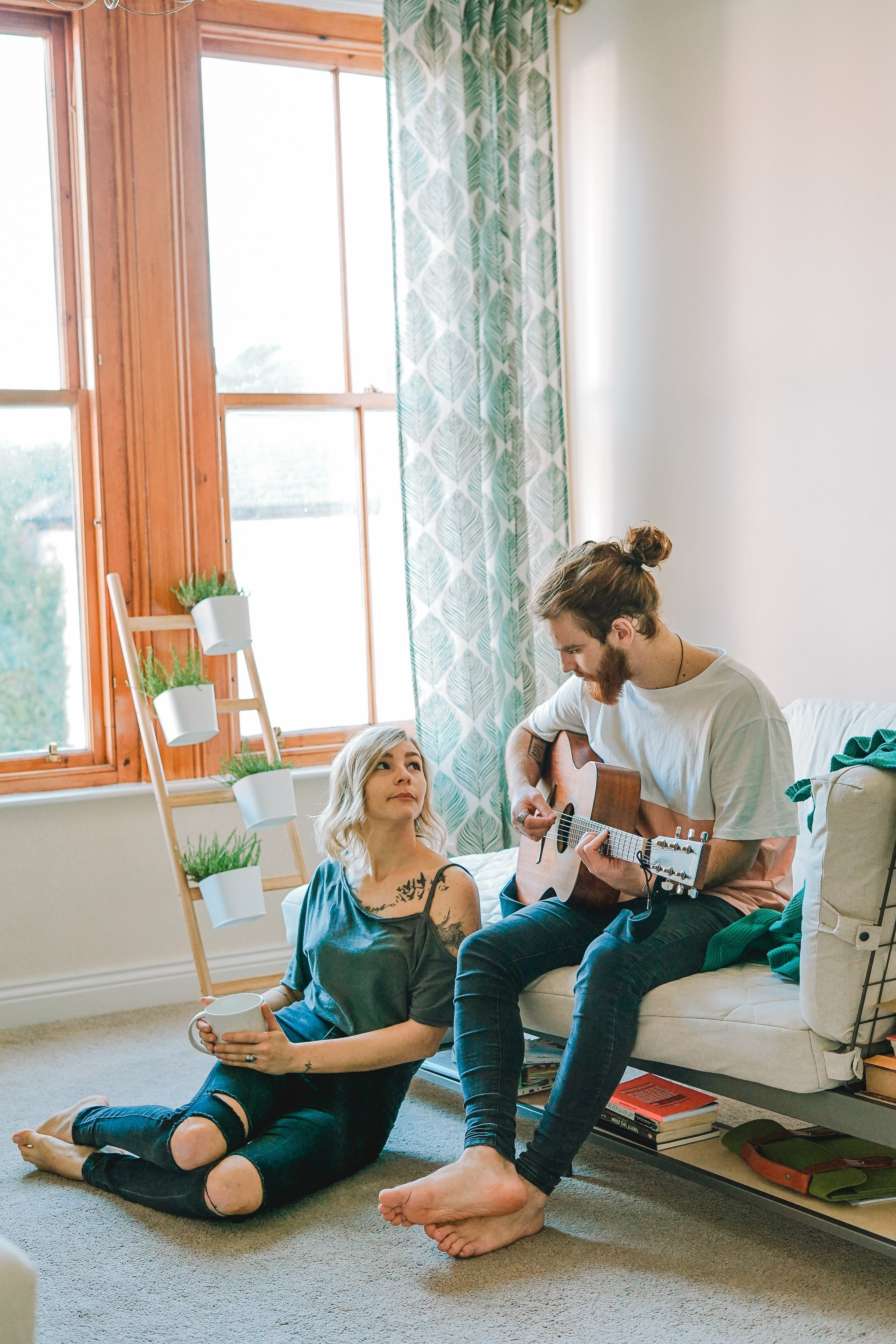 Man playing a guitar for his girlfriend   Photo: Unsplash
