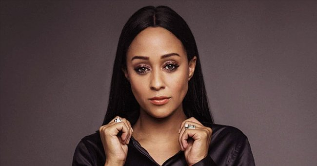 Fans Love Tia Mowry's Bold Looks in Belted Black Dress with Crucifix Chain in a New Photo