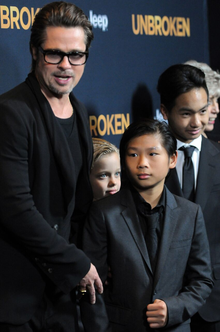 """Brad Pitt with children Pax, Shiloh and Maddox arrives for the Premiere Of Universal Studios' """"Unbroken"""" held at The Dolby Theatre on December 15, 2014 in Hollywood, California. 