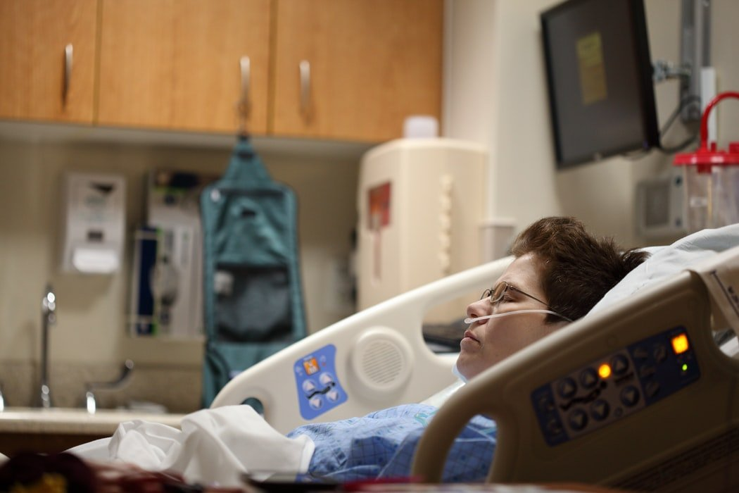 Woman in a hospital bed   Source: Unsplash