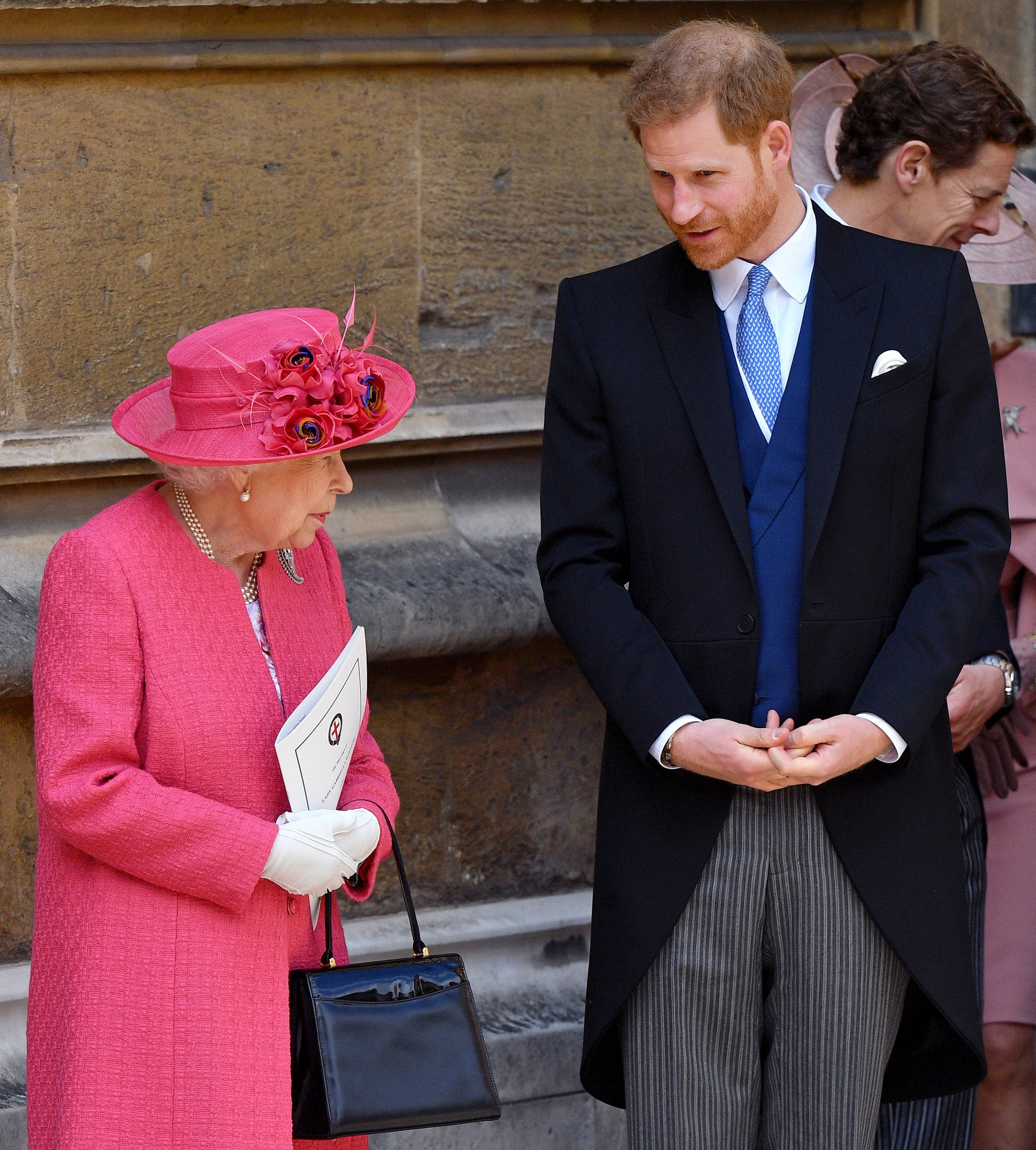 Queen Elizabeth II and Prince Harry otuside St George's Chapel in Windsor Castle, England | Photo: Getty Images