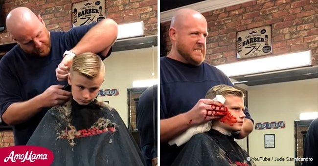 Ein 10-Jähriger schreit entsetzt, nachdem der Friseur so tut, als ob er ihm das Ohr abgeschnitten hätte
