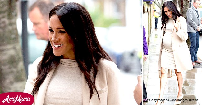 Meghan Markle flashes toned legs and cradles her huge baby-bump while visiting an animal shelter