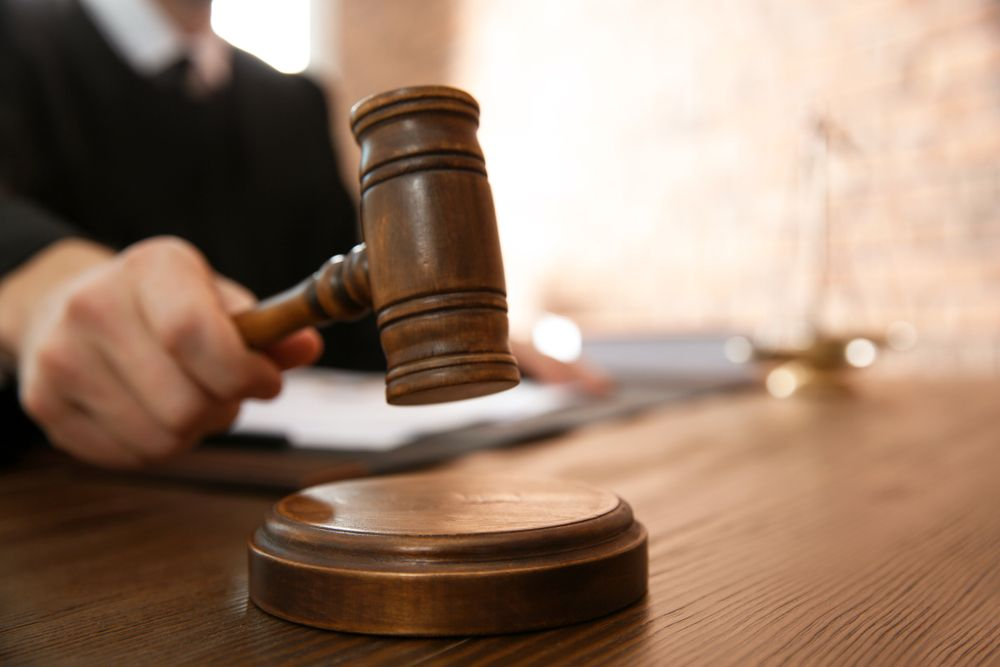 A judge pounds the gavel during a court trial.   Source: Shutterstock