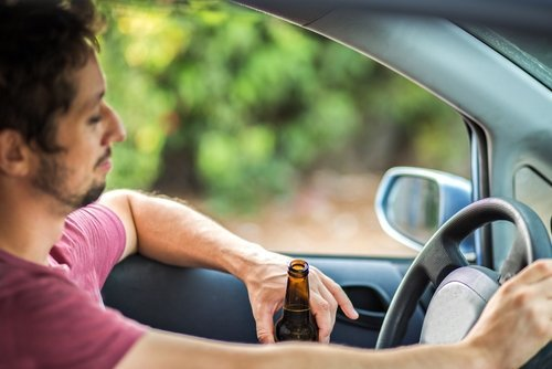 A man drinking and driving. | Source: Shutterstock.