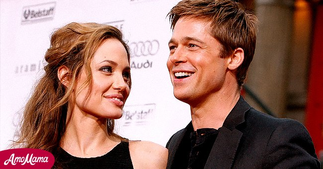 Brad Pitt and Angelina Jolie smiling for a photo | Photo: Getty Images
