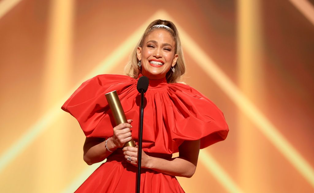 Jennifer Lopez accepted the People's Icon of 2020 award onstage for the 2020 E! People's Choice Awards on Sunday, November 15, 2020   Photo: Getty Images