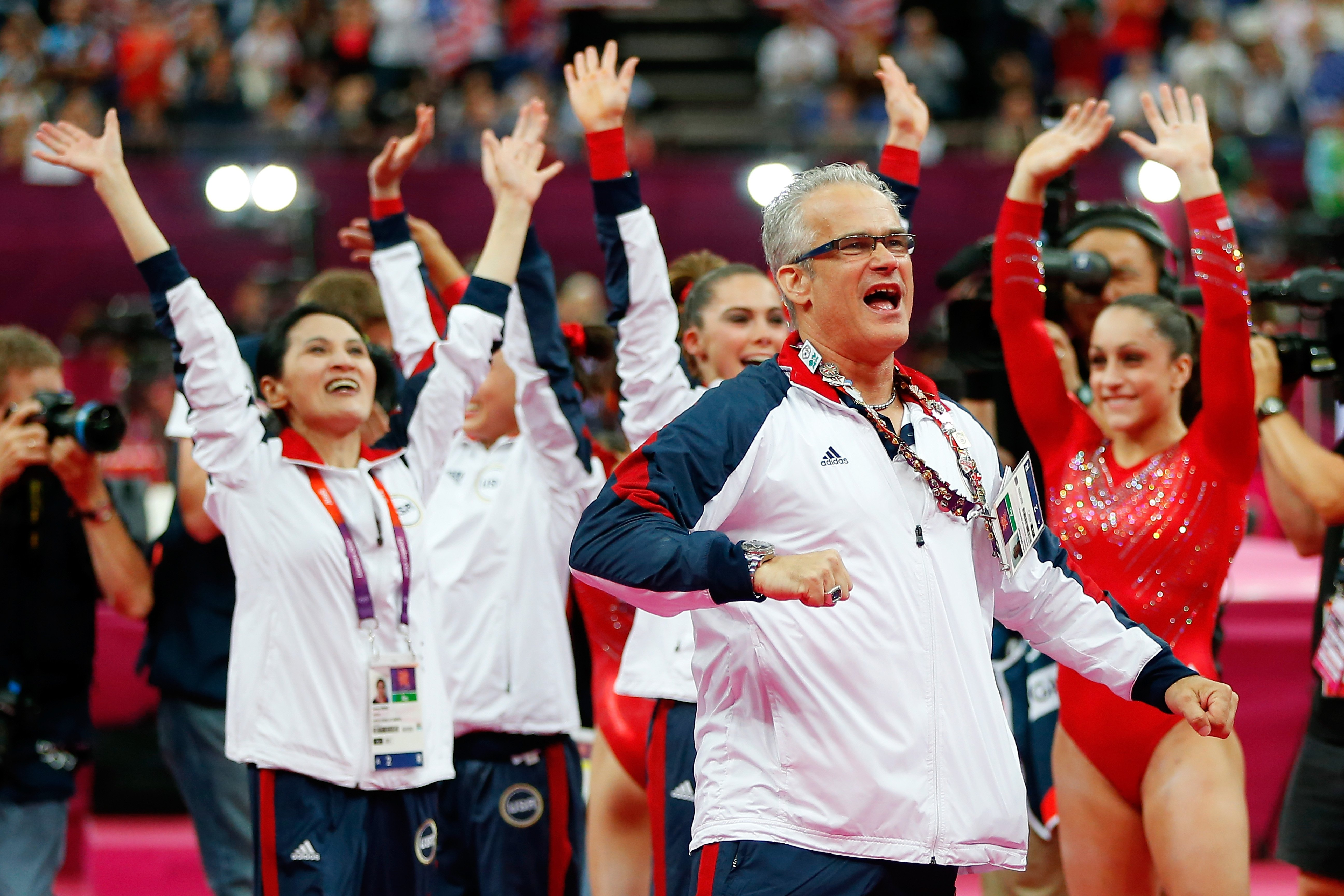 United States women's gymnastics coach John Geddert celebrating during the final rotation in the Artistic Gymnastics Women's Team final at the London 2012 Olympic Games at North Greenwich Arena in London, England | Photo: Jamie Squire/Getty Images