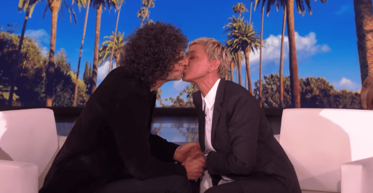 Howard Stern and Ellen DeGeneres kiss during his appearance on the Ellen Show. | Source: YouTube/TheEllenShow