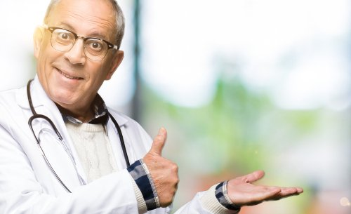 A male doctor showing the thumbs up sign that everything is good. | Source: Shutterstock.