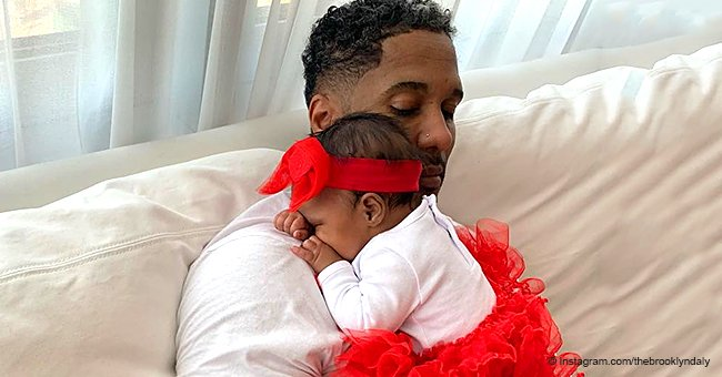 Kenya Moore's baby steals hearts in red tutu & matching bow, resting on her 'Valentine' in new pic