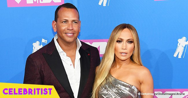Jennifer Lopez hits the red carpet in sparkly silver gown with Alex Rodriguez at MTV VMAs