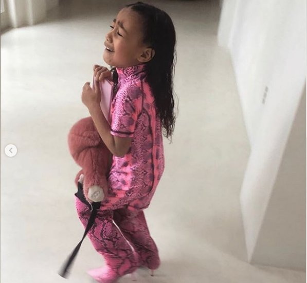 North West refusing to take off mom's boots/ Source: Instagram/Kim Kardashian