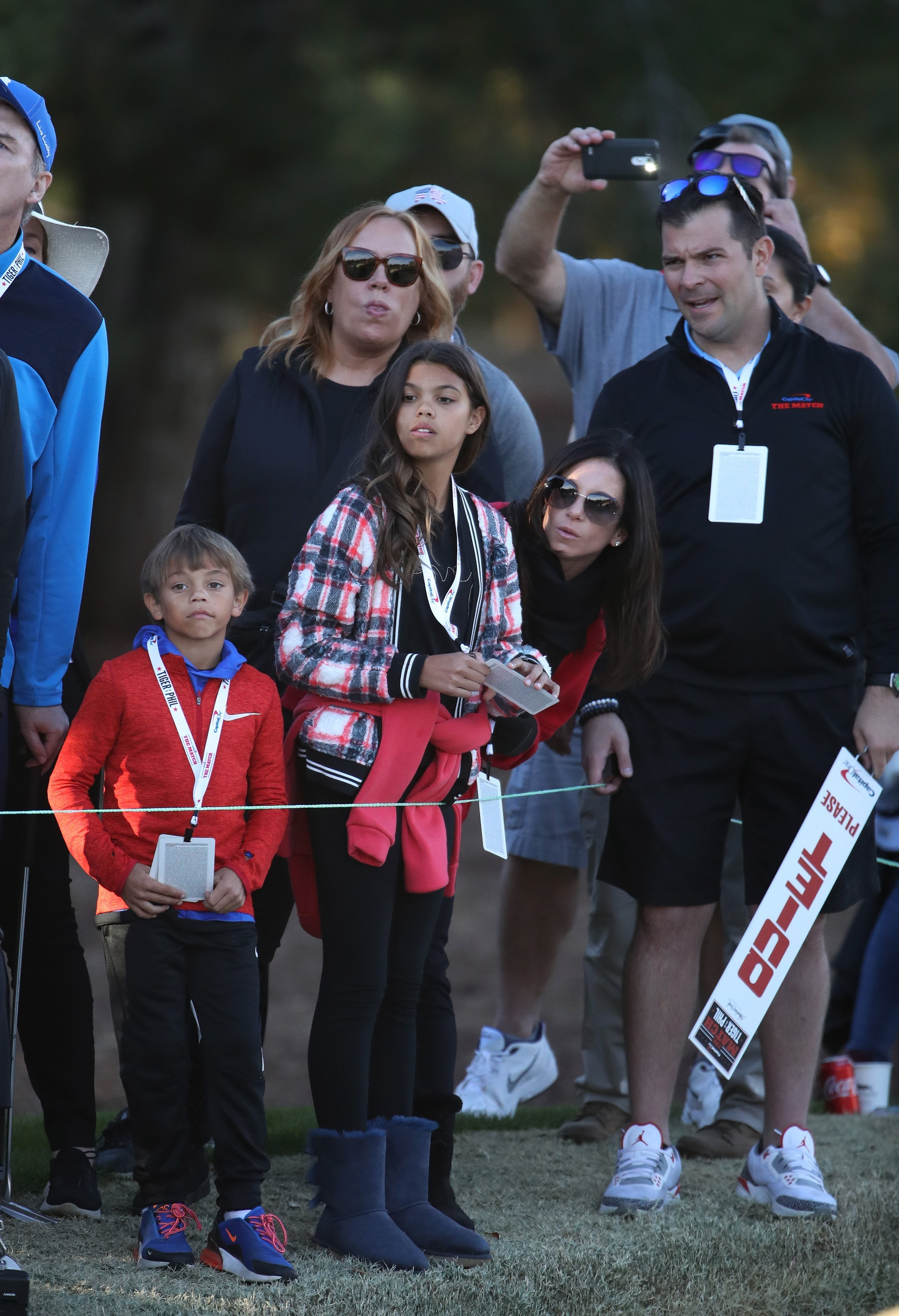 Erica Herman, girlfriend of Tiger Woods, and his children Sam and Charlie look on during The Match: Tiger vs Phil at Shadow Creek Golf Course on November 23, 2018, in Las Vegas, Nevada. | Source: Getty Images.