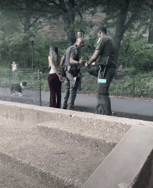 Dora Marchand being handcuffed by New York park officers. | Source: youtube.com/WestSideRag