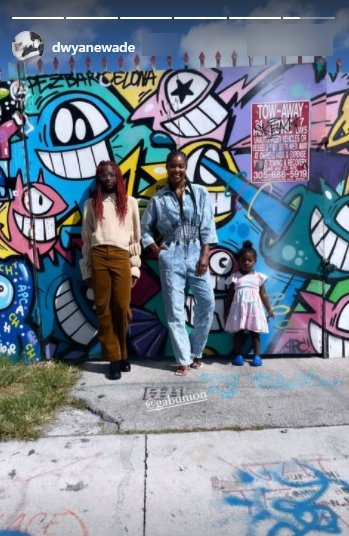 Dwyane Wade's daughter, Zaya, posing for a picture with her half sister, Kaavia and stepmom Gabrielle Union in front of a mural   Photo: Instagram/dwyanewade