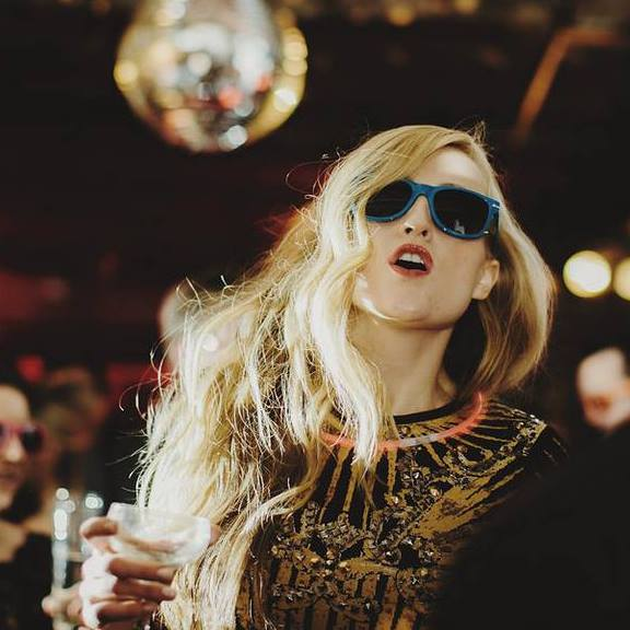 AnnaRose King having fun at an event, with champagne in hand, May 2015. | Photo: Facebook/AnnaRose King.