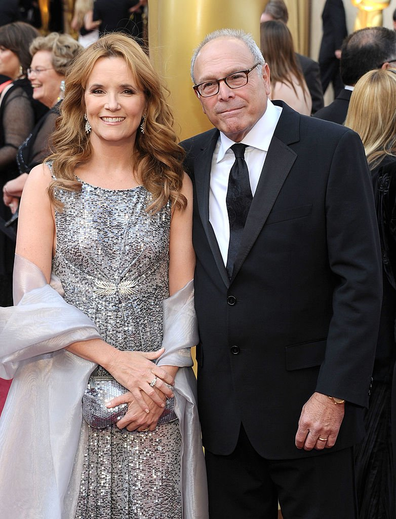 Actress Lea Thompson (L) and Howard Deutch arrive at the 84th Annual Academy Awards held at the Hollywood & Highland Center on February 26, 2012 in Hollywood, California.   Source: Getty Images