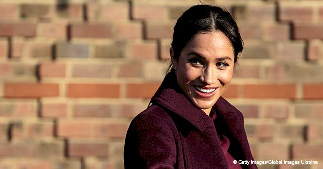 Meghan Markle hides her baby bump in long Club Monacco coat and matching loose dress in recent pics
