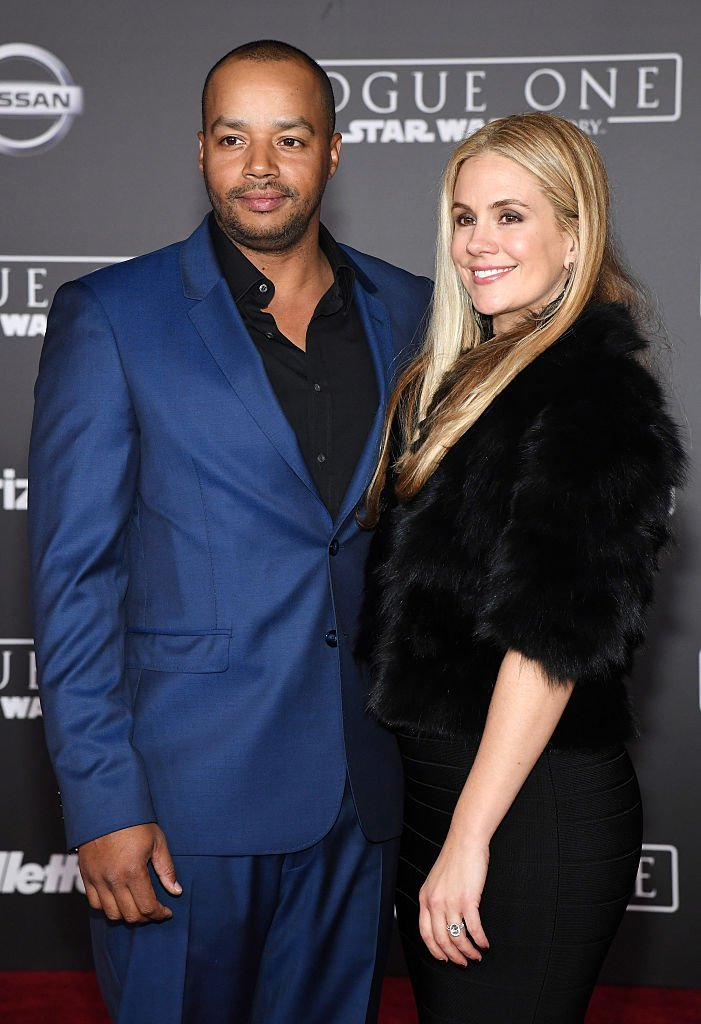 """Actor Donald Faison (L) and his wife CaCee Cobb attend the premiere of Walt Disney Pictures and Lucasfilm's """"Rogue One: A Star Wars Story"""" at the Pantages Theatre 
