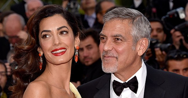 """Amal and George Clooney at the """"Money Monster"""" premiere during the 69th annual Cannes Film Festival on May 12, 2016.  