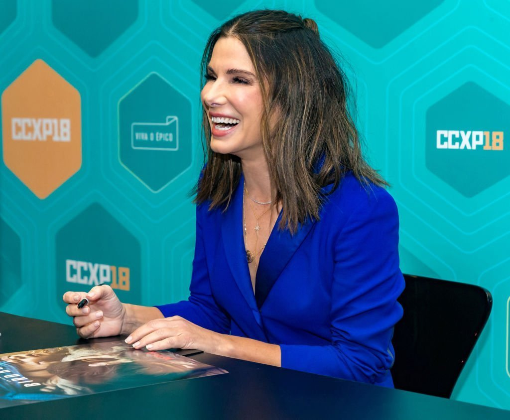 Sandra Bullock signs autographs at Comic-Con São Paulo on December 9, 2018 in Sao Paulo, Brazil | Photo: Getty Images