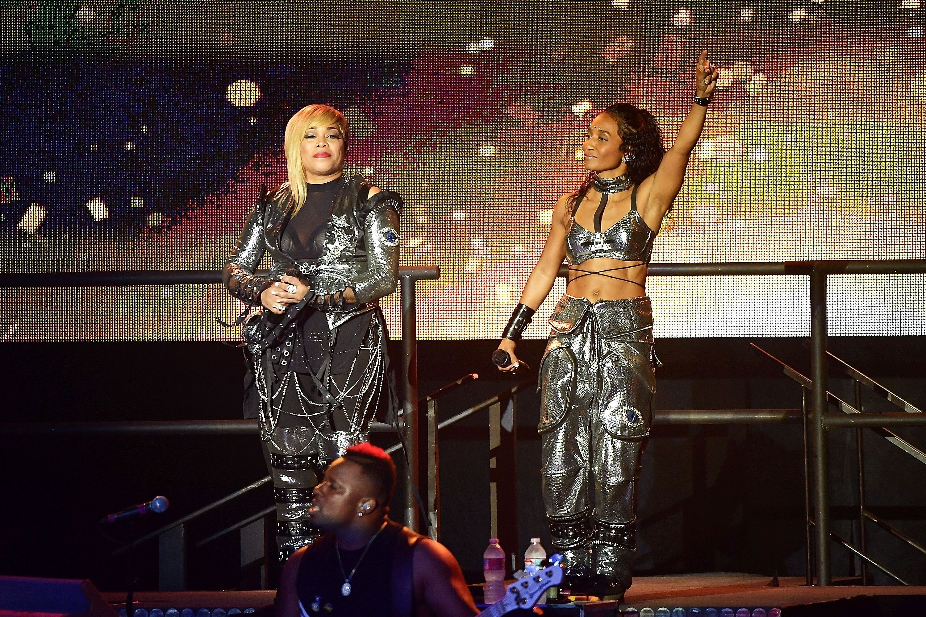 Tionne 'T-Boz' Watkins and Rozonda 'Chilli' Thomas perform as TLC during the I Love The 90s The Party Continues on July 14, 2017, in Los Angeles, California | Source: Matt Winkelmeyer/Getty Images