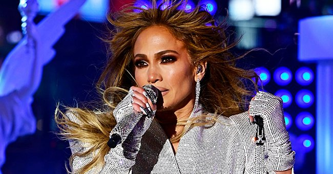 Jennifer Lopez Looks Perfectly Content Posing in a Bralette & Fishnet Leggings — See Photos