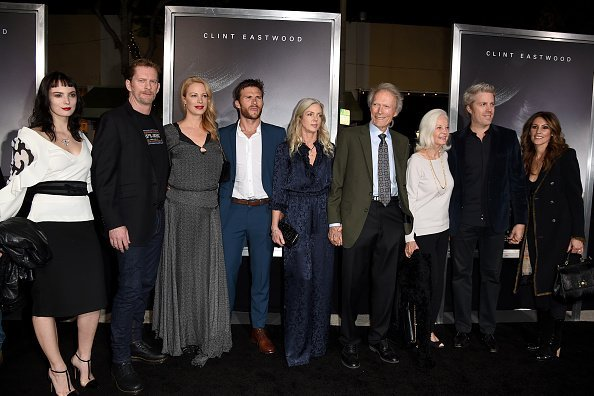 Graylen Eastwood, Stacy Poitras, Alison Eastwood, Scott Eastwood, Christina Sandera, Clint Eastwood, Maggie Johnson, Kyle Eastwood and Cynthia Ramirez at the Village Theatre on December 10, 2018 in Los Angeles, California. | Photo: Getty Images