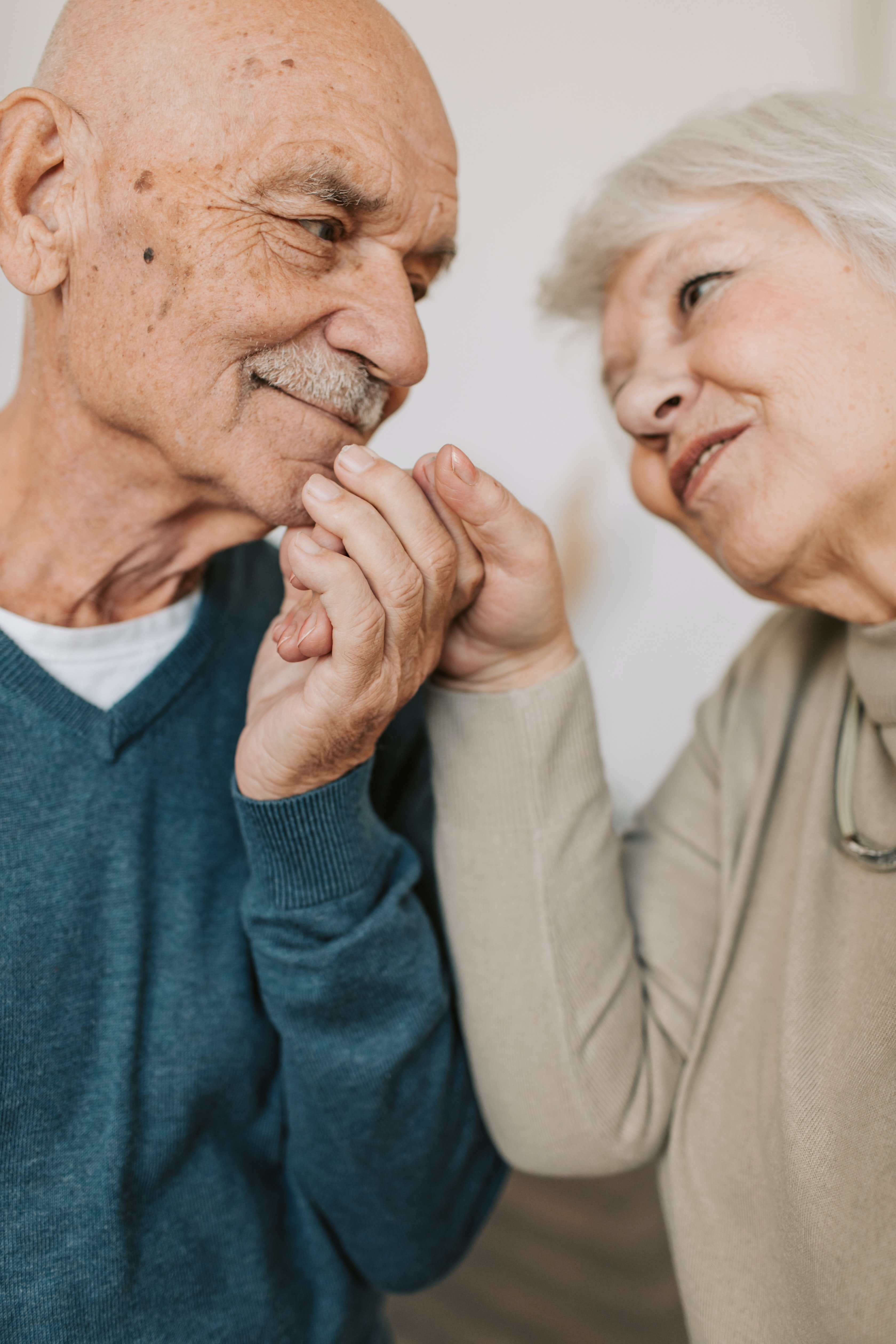 An elderly couple looking at each other lovingly.   Source: Pexels/ Vlada Karpovich