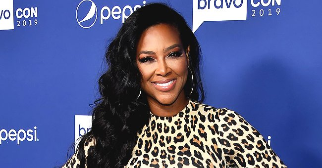 Kenya Moore Shows off Fit Figure in Leopard-Print Coat Dress and High Heel Boots