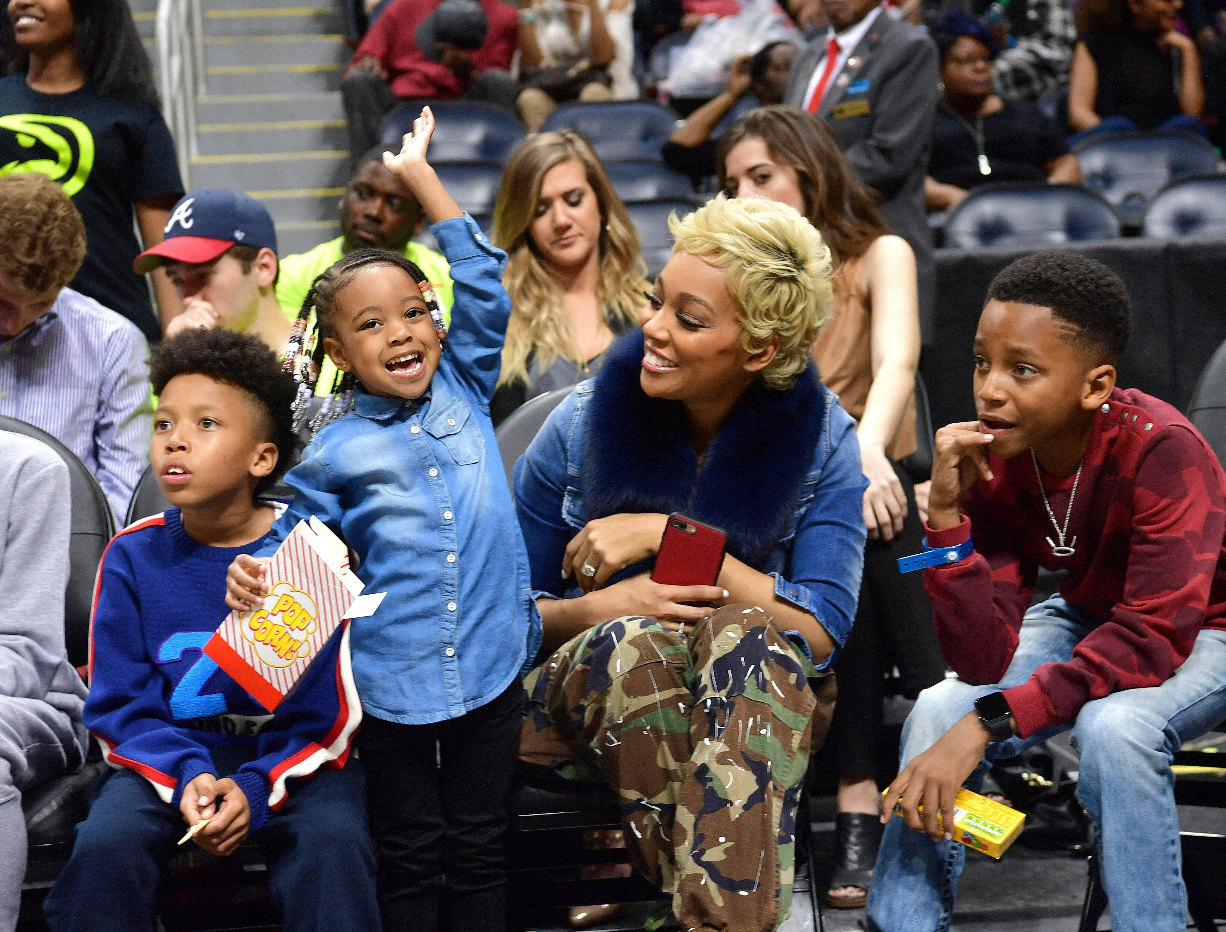 Monica & her kids (L-R) Romelo, Laiyah & Rodney at a basketball game in Atlanta, Georgia on March 1, 2017. | Photo: Getty Images