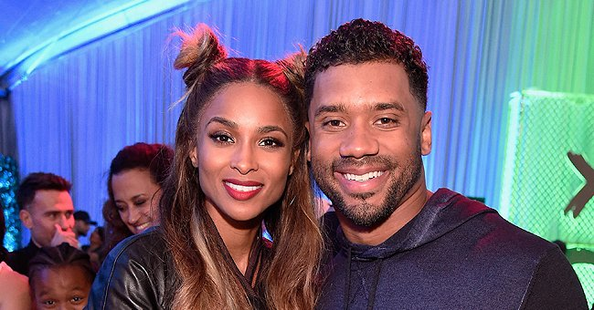 Russell Wilson's Son Win Captures Fans' Hearts Smiling in Cute Snap While Sitting on Dad's Lap