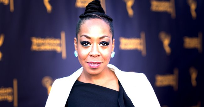 Tichina Arnold's Daughter Rocked Cropped Top, Jeans, & Thigh-High Boots in Pics