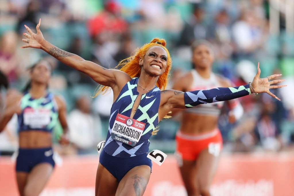 Sha'Carri Richardson celebrates winning the Women's 100 Meter final on day 2 of the 2020 U.S. Olympic Track & Field Team Trials at Hayward Field on June 19, 2021   Photo: Getty Images