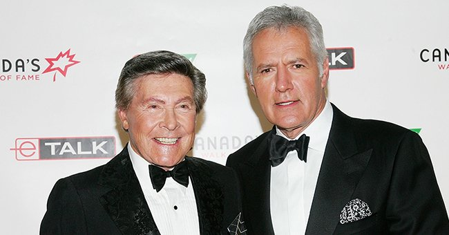 Johnny Gilbert and Alex Trebek attend Canada's Walk Of Fame Gala sponsored by Chanel at the HummingBird Centre June 3, 2006 in Toronto, Canada | Photo: Getty Images