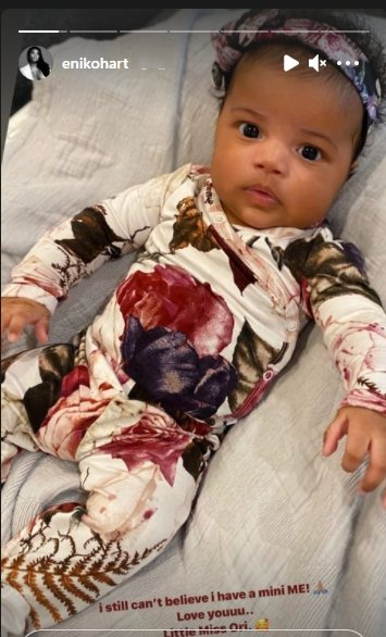 Kevin Hart's daughter, Kaori, staring at the camera dressed up in a onesie | Photo: Instagram/enikohart