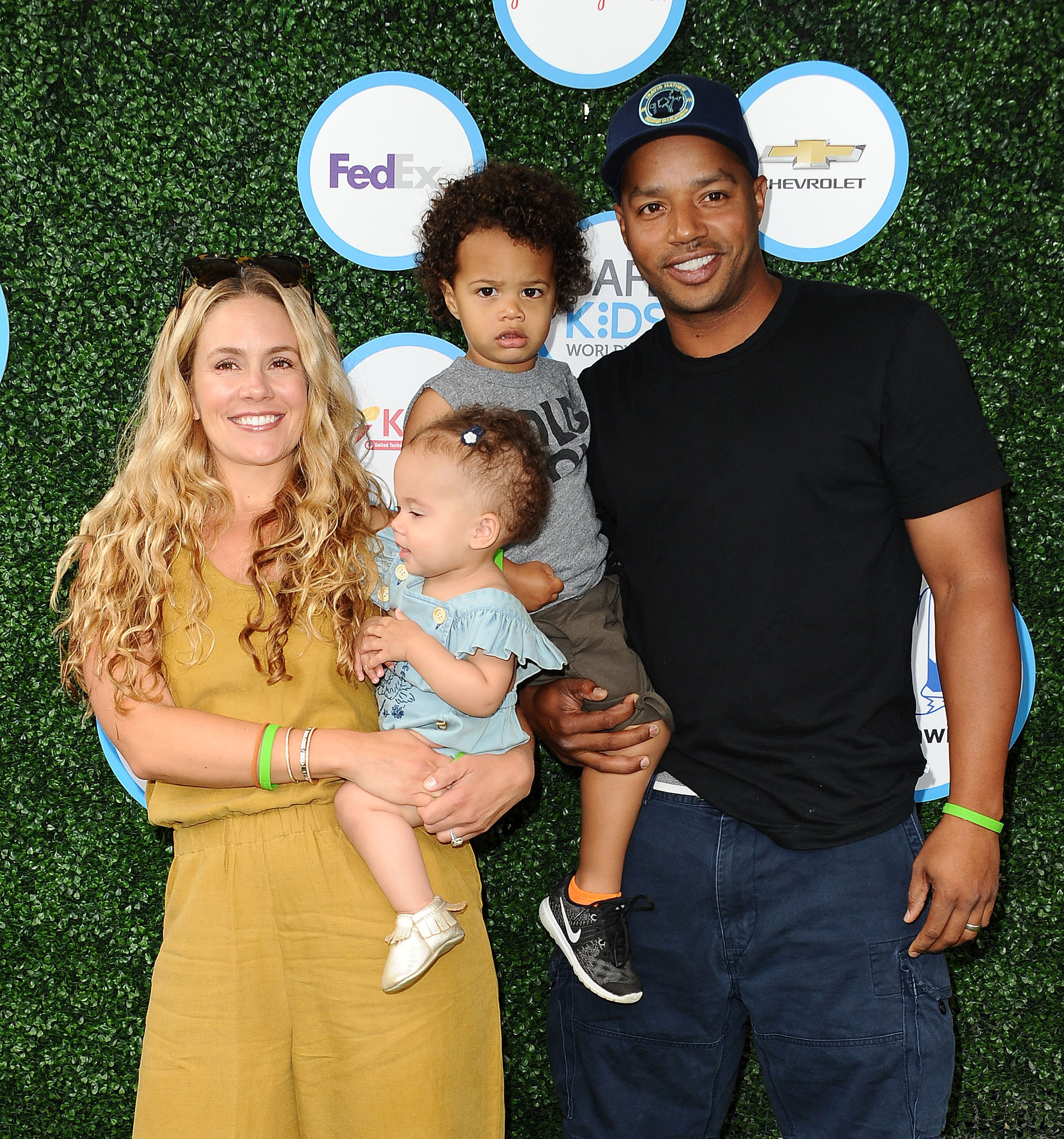 CaCee Cobb, Donald Faison, Wilder Frances Faison and Rocco Faison at Safe Kids Day at Smashbox Studios on April 24, 2016 in Culver City, California | Photo: Getty Images